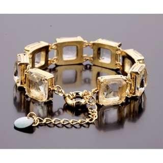 Elegant princess-cut glass and gold bracelet