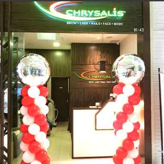 Shop front balloon columns for grand opening anniversary promotion