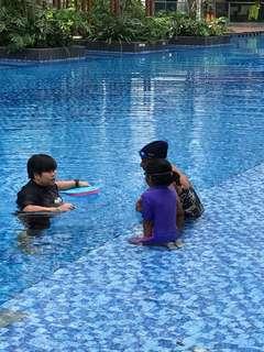 Swimming coach / teacher / instructor