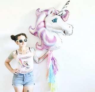 Unicorn foil balloon in purple
