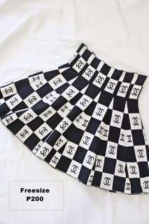 PLEADED SKIRT WITH CHANEL LOGO