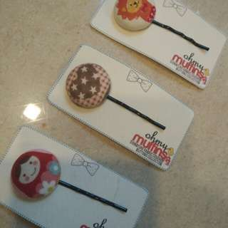Brand new hair clips with fabric buttons detailing