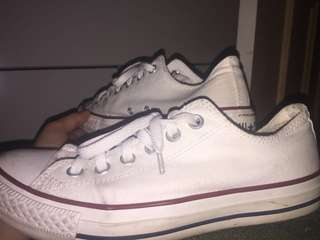 White/cream colour with red lining low converse