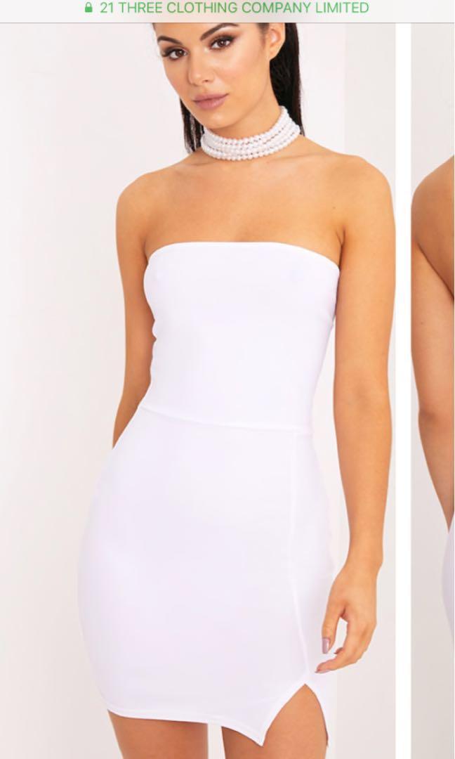 Strapless white body one dress with slit at bottom