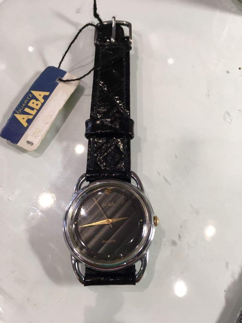 Vintage Retro Black Alba Watch With Convex Surface And Golden Hands Photo
