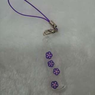 Purple flower in cola bottle keychain