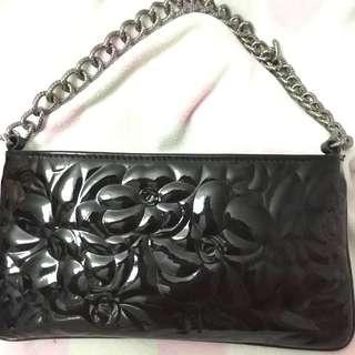 CHANEL camellia black patent leather bag