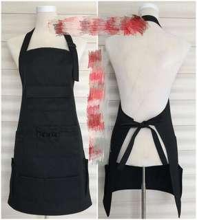 Multiple pockets make up apron