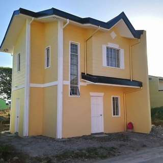 Woodside homes along the highway Tanza Trece Road