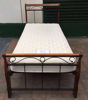 Excellent single bed metal frame with mattress. Delivery availabl