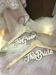 The bride and groom wedding hanger