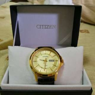 Citizen quartz gold dress watch with leather band