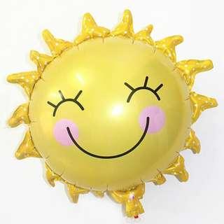 Smiling sun balloon