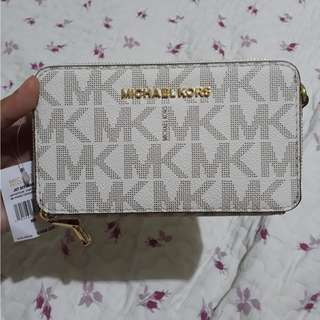 Michael Kors (wallet/cellphone holder) with strap