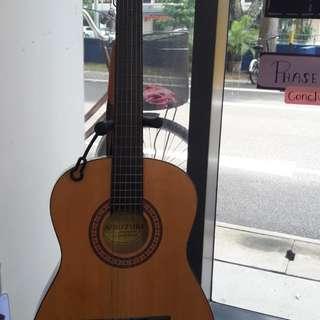 suzuki guitar and tennesse ukulele