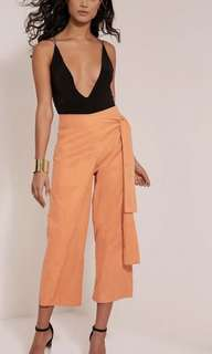 Pretty little hung suede feel pastel orange culottes. Brand new with tag