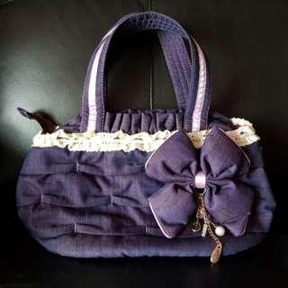 Naraya Handbag with ribbon keychain