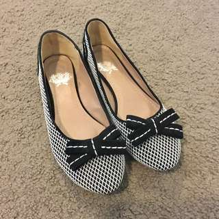 Black and white ballet flats