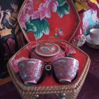 Vintage tea pot with warmer basket