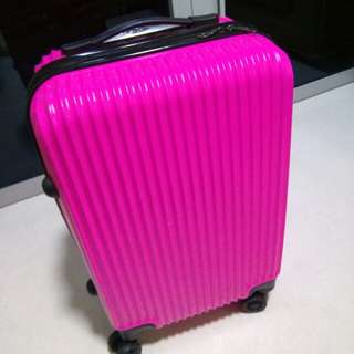 Pink cabin size luggage