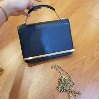 Tas pesta Charles & keith