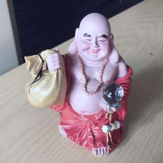 Laughing Buddha with money bag
