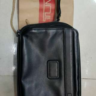 Tumi clutch bag