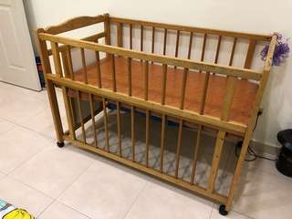 Preloved solid wood baby cot