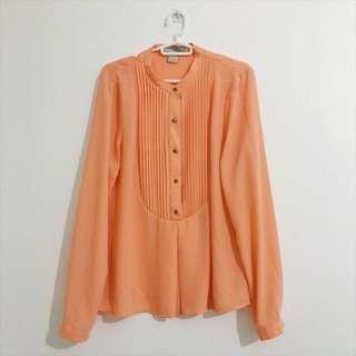 Pastel orange blouse