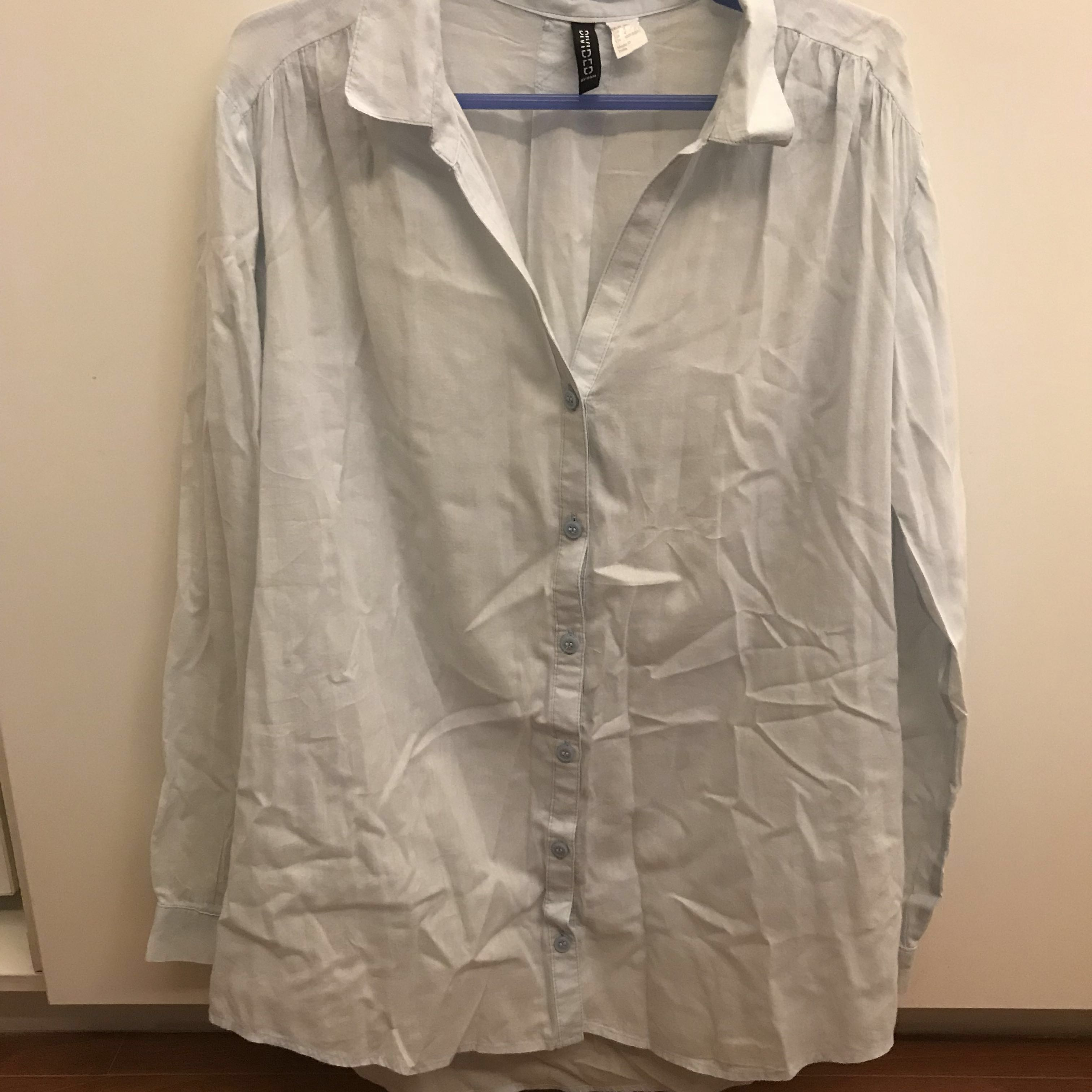 H&M light blue long sleeved button down oversized top
