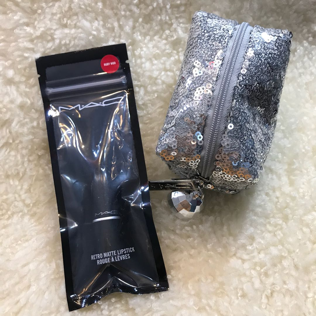 MAC Ruby Woo Travel Size Lipstick with silver sequined statement bag