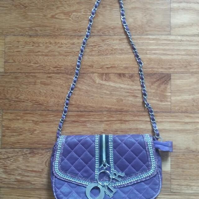 Purple sling bag