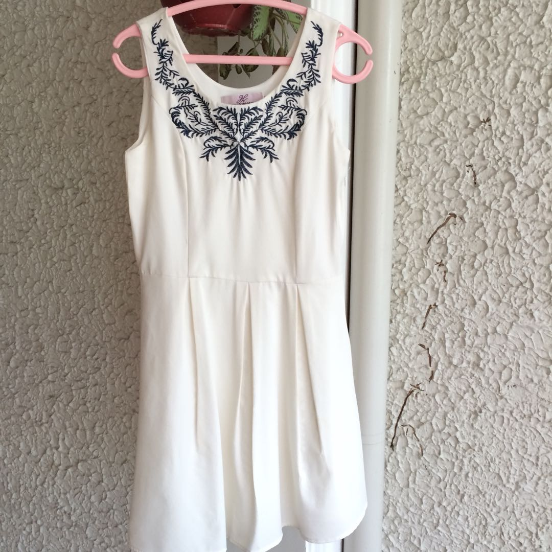 White dress with embroidery