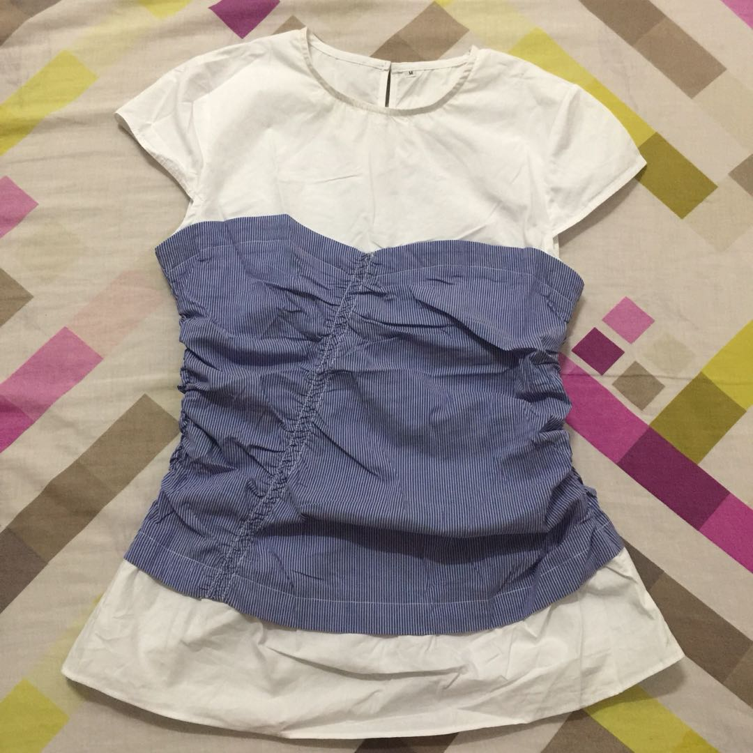 White top with blue tube