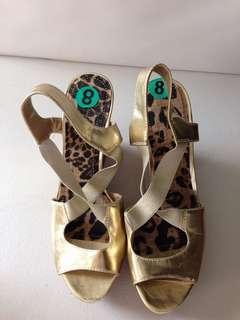 Jessica Simpson gold pumps