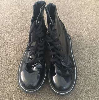 Black glossy ankle boots