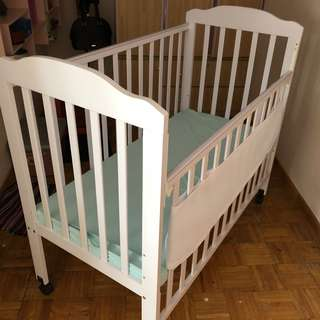Baby wooden cot & brand new IKEA baby mattress