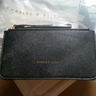charles and keith hand pouch