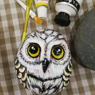 Owl painting on rock