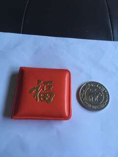 Spore 1985 Year of Cow $10 UNC Coin