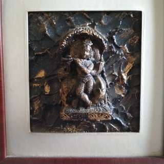 Indian 3d statue mounted on frame