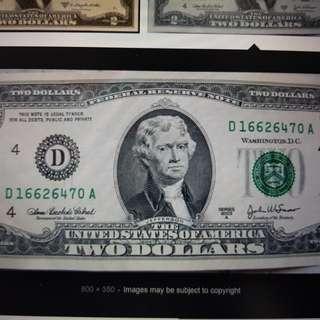 Buying US 2 dollar bill