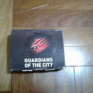 Guardians Of The City Total Defence Card Game. Really fun and addictive card game, no regrets, really rare and hard to find this outside! So what are u waiting for? Grab it before its sold!