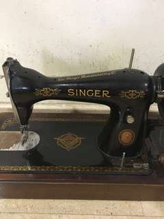 Old portable Singa sewing machine with cover