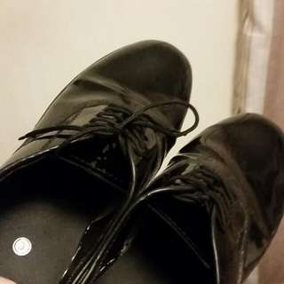 Black shiny tie dress shoes
