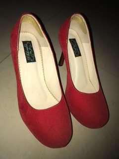 Red suede pump heels