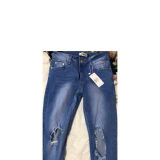 SHOWPO BLUE RIPPED JEANS