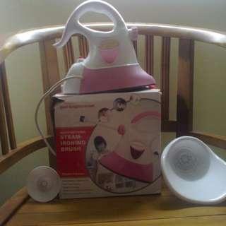 Multifunctional steam-ironing brush