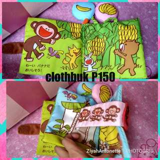 clothbook w/ hanging toy