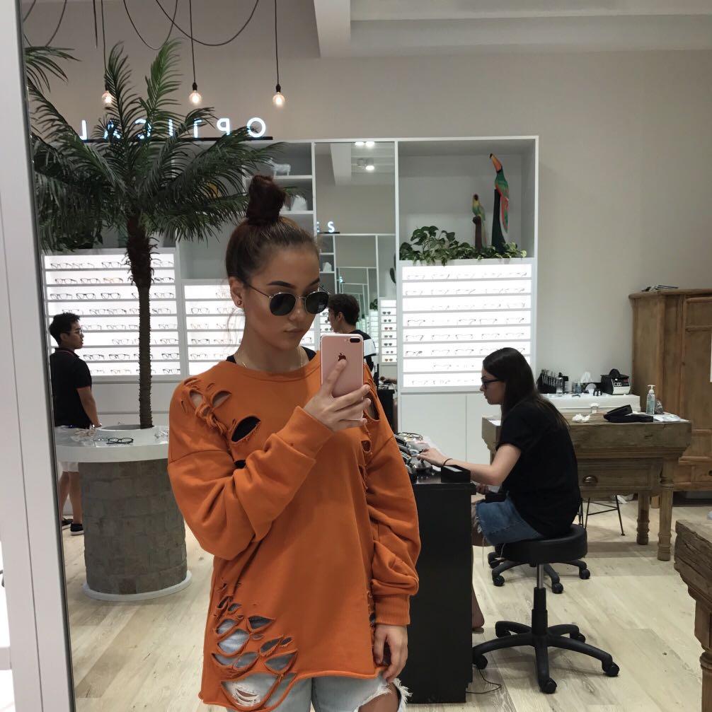 Distressed orange jumper/top